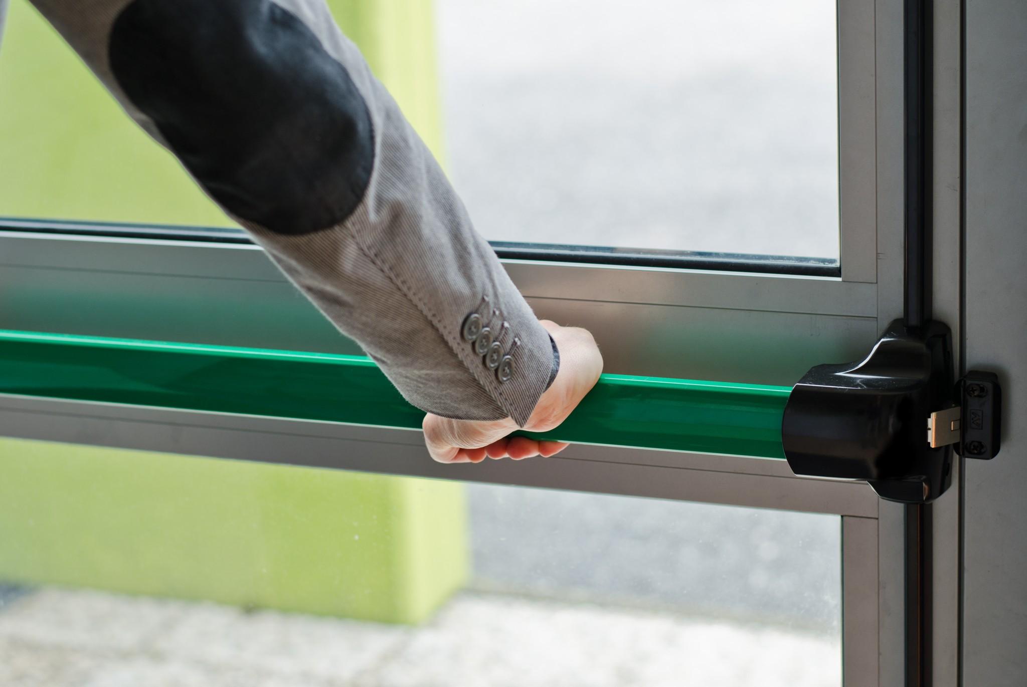 bigstock-Hand-Pressing-Panic-Push-Bar-T-52347697